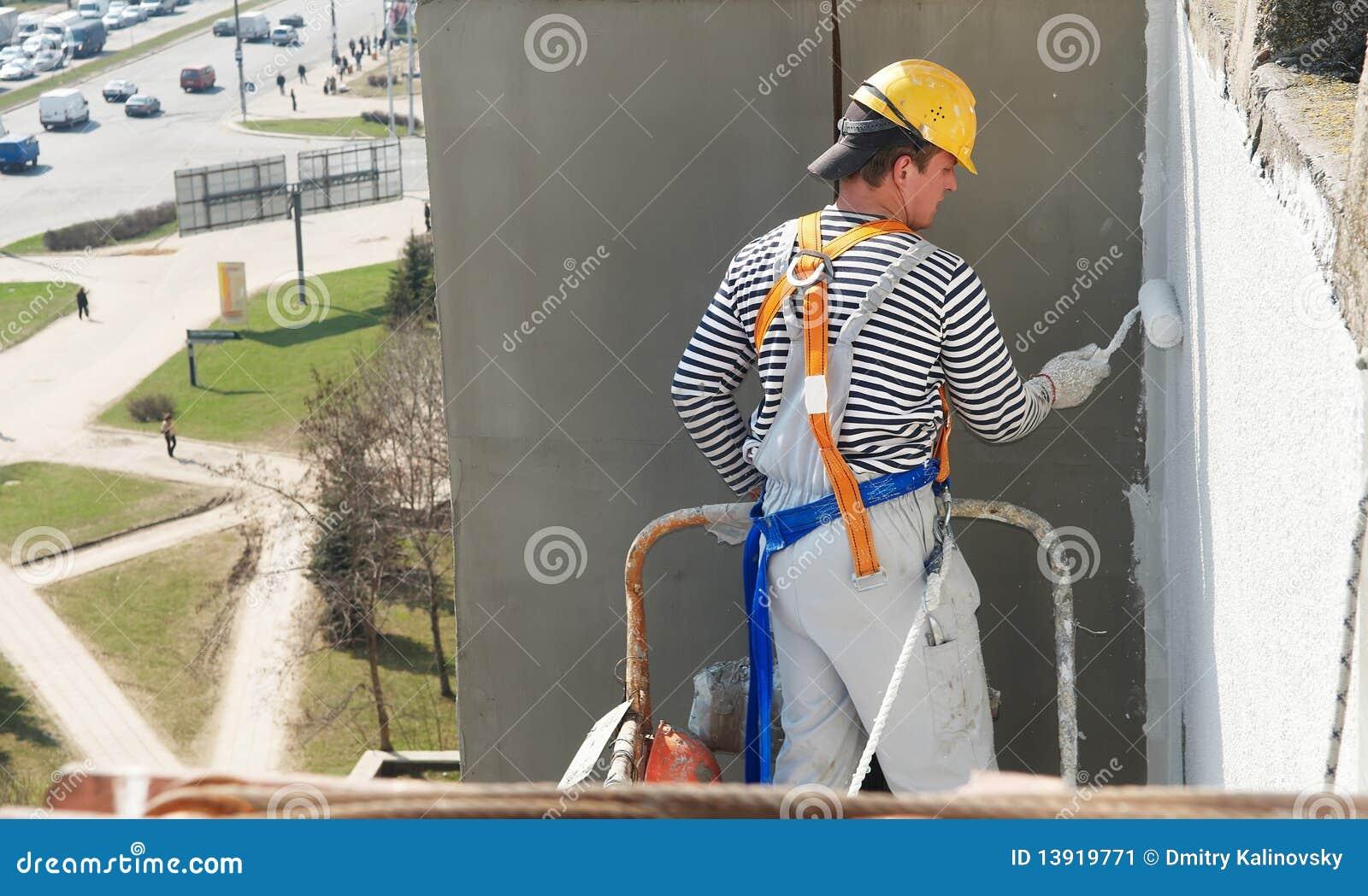 Pintor de la fachada del constructor en el trabajo imagen - Trabajo de pintor en barcelona ...