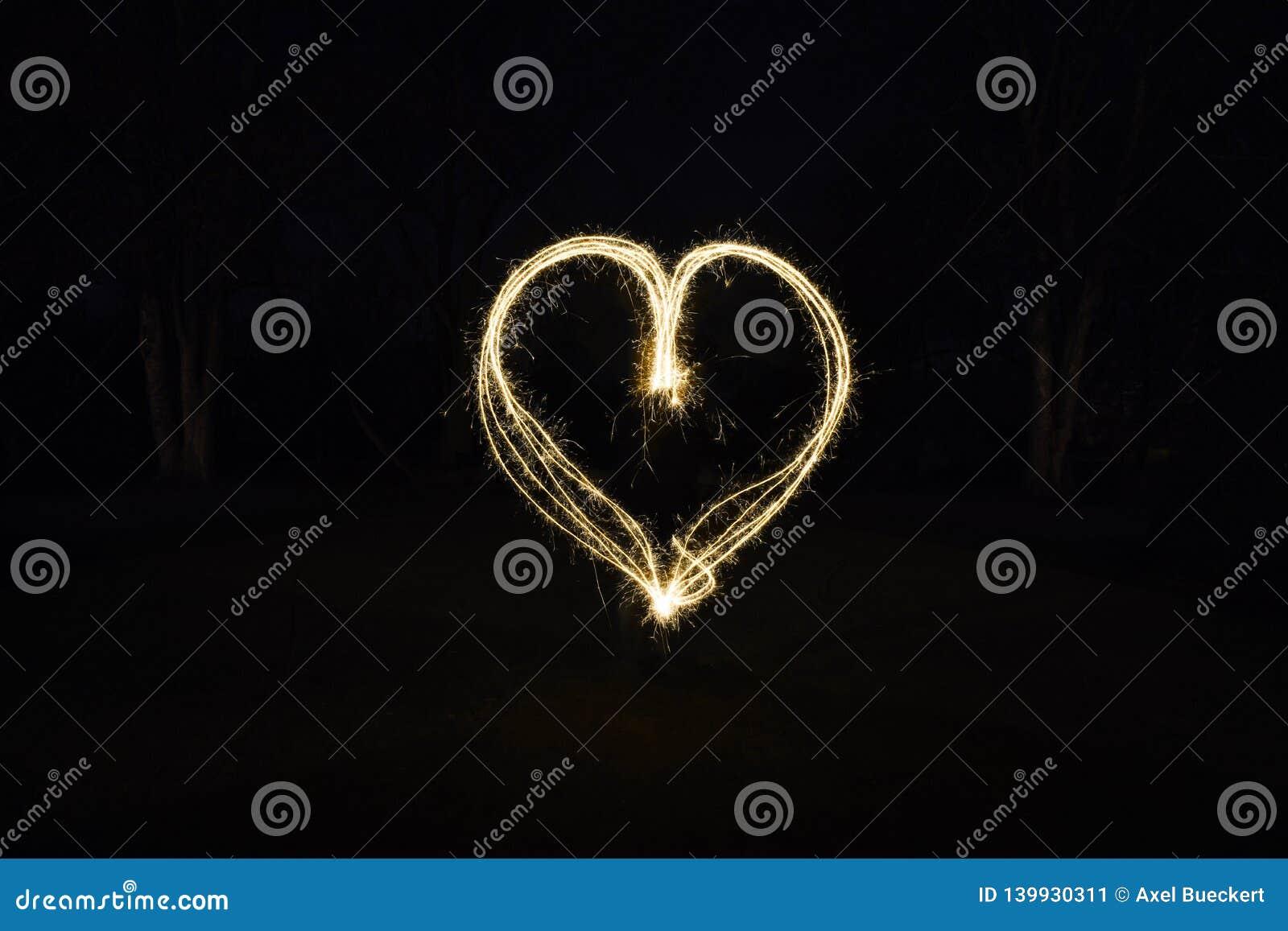 Pintura de la luz de la forma del corazón con las bengalas