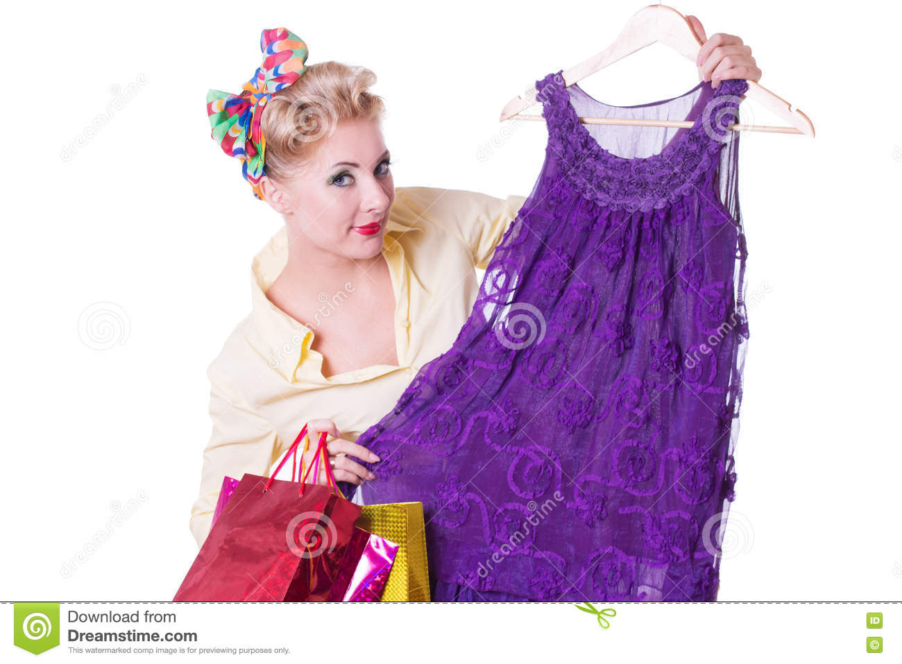 Pinup woman showing dresses with shopping bags