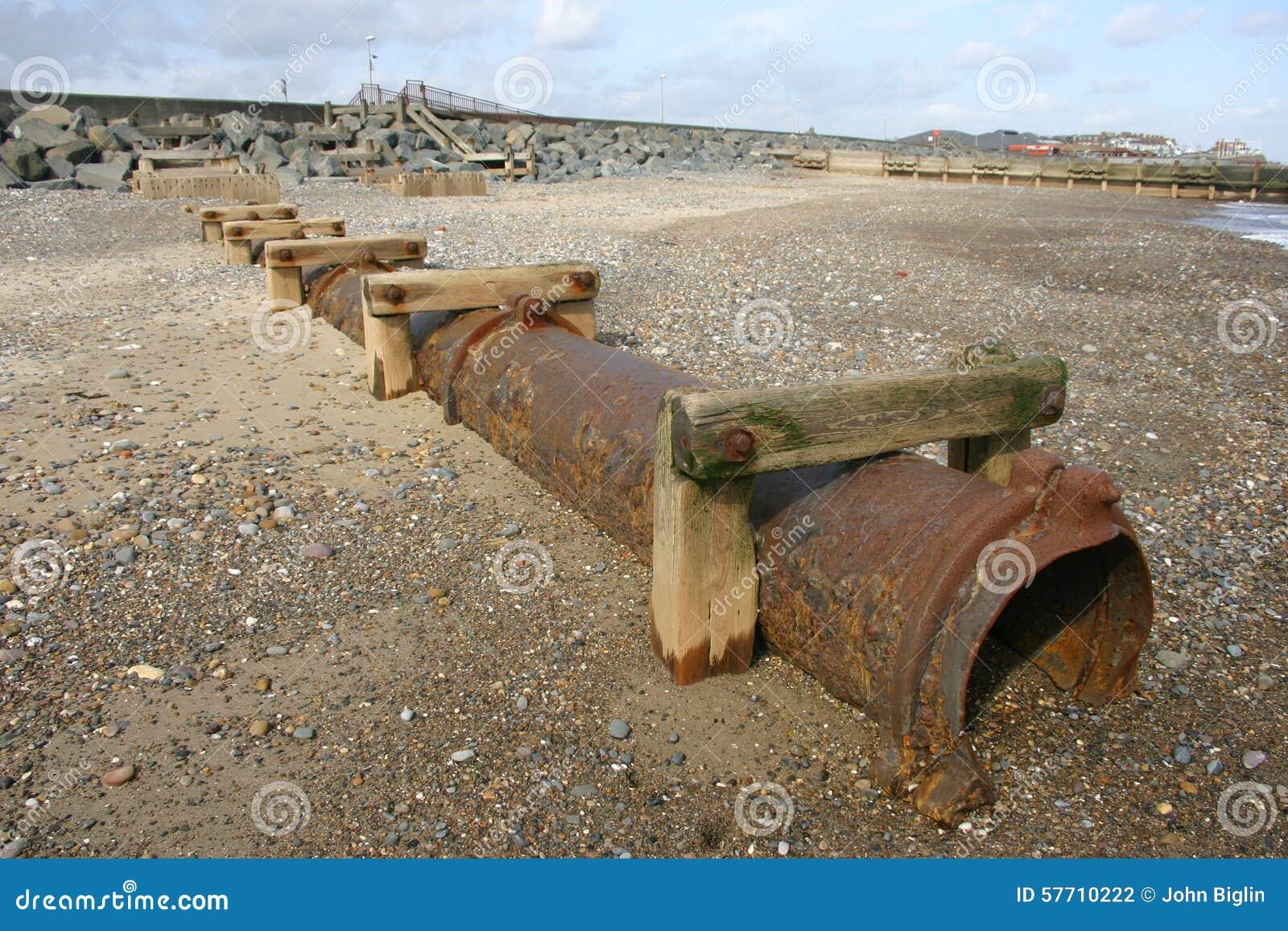 Rusty drain pipe on the beach