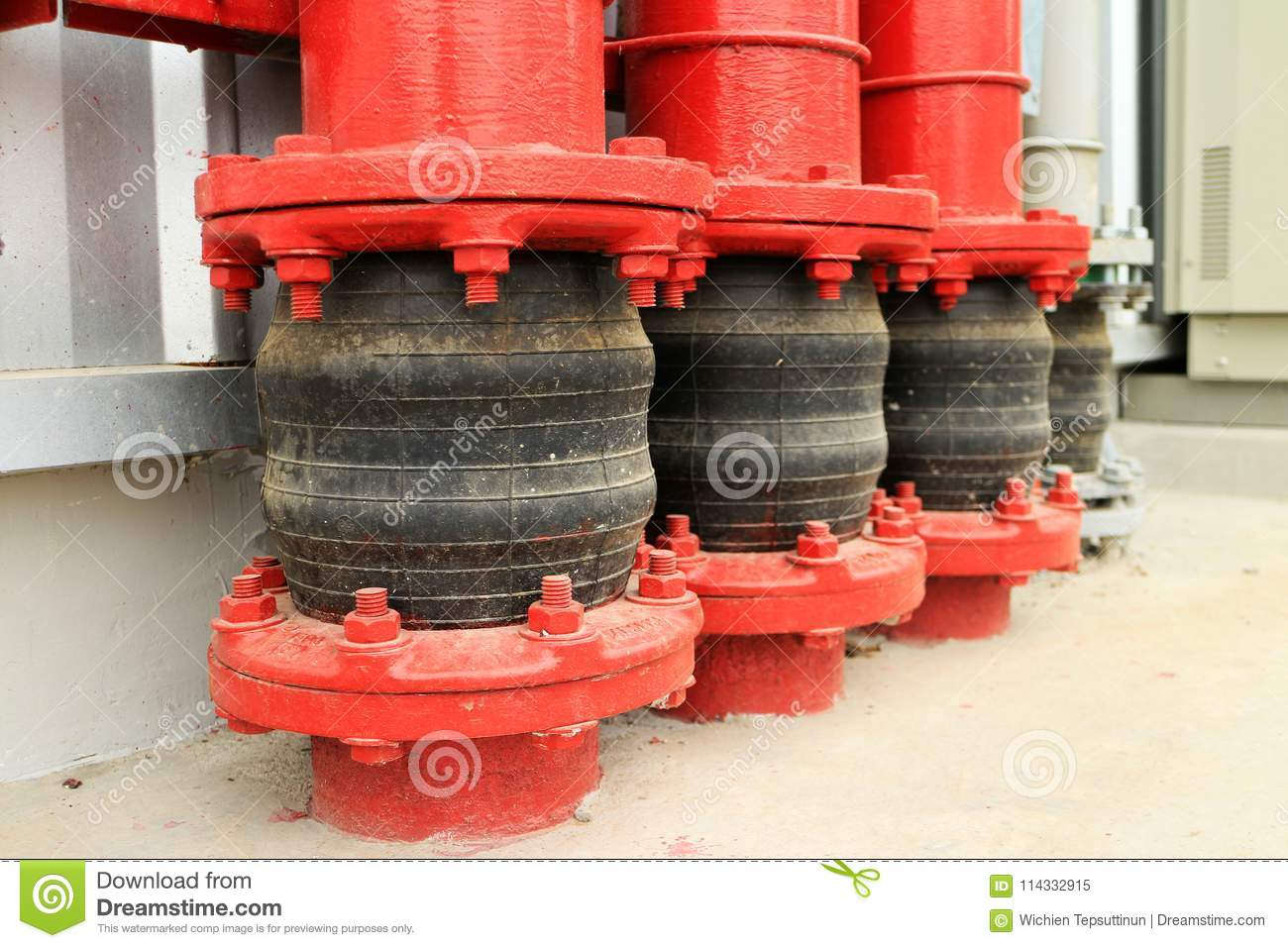 Pipe Vibration Isolator of the Fire Water Pipe at Ground Entry providing flexibility to the piping when the pipe vibrate and ground settle. & Pipe Vibration Isolator At Ground Entry Stock Image - Image of ...
