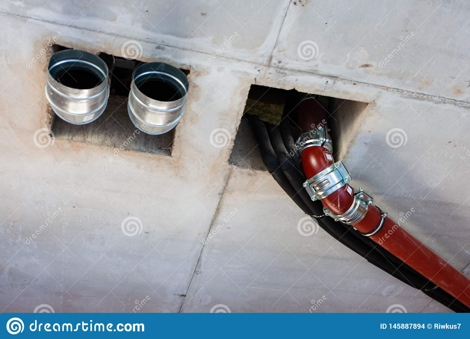 Pipes of sewage, ventilation, water supply in the created interior