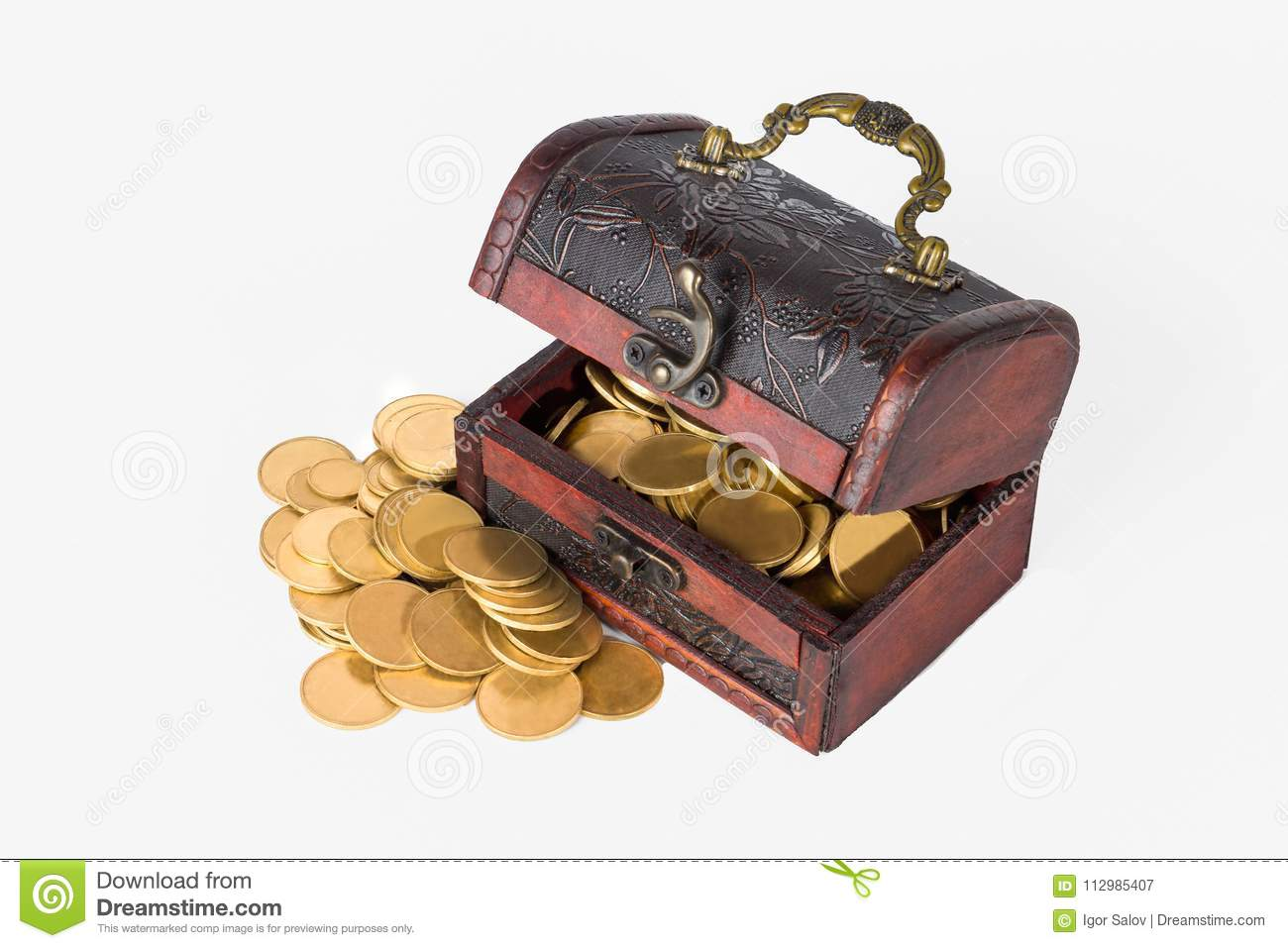 Pirate chest with scattered golden coins on a white background isolate