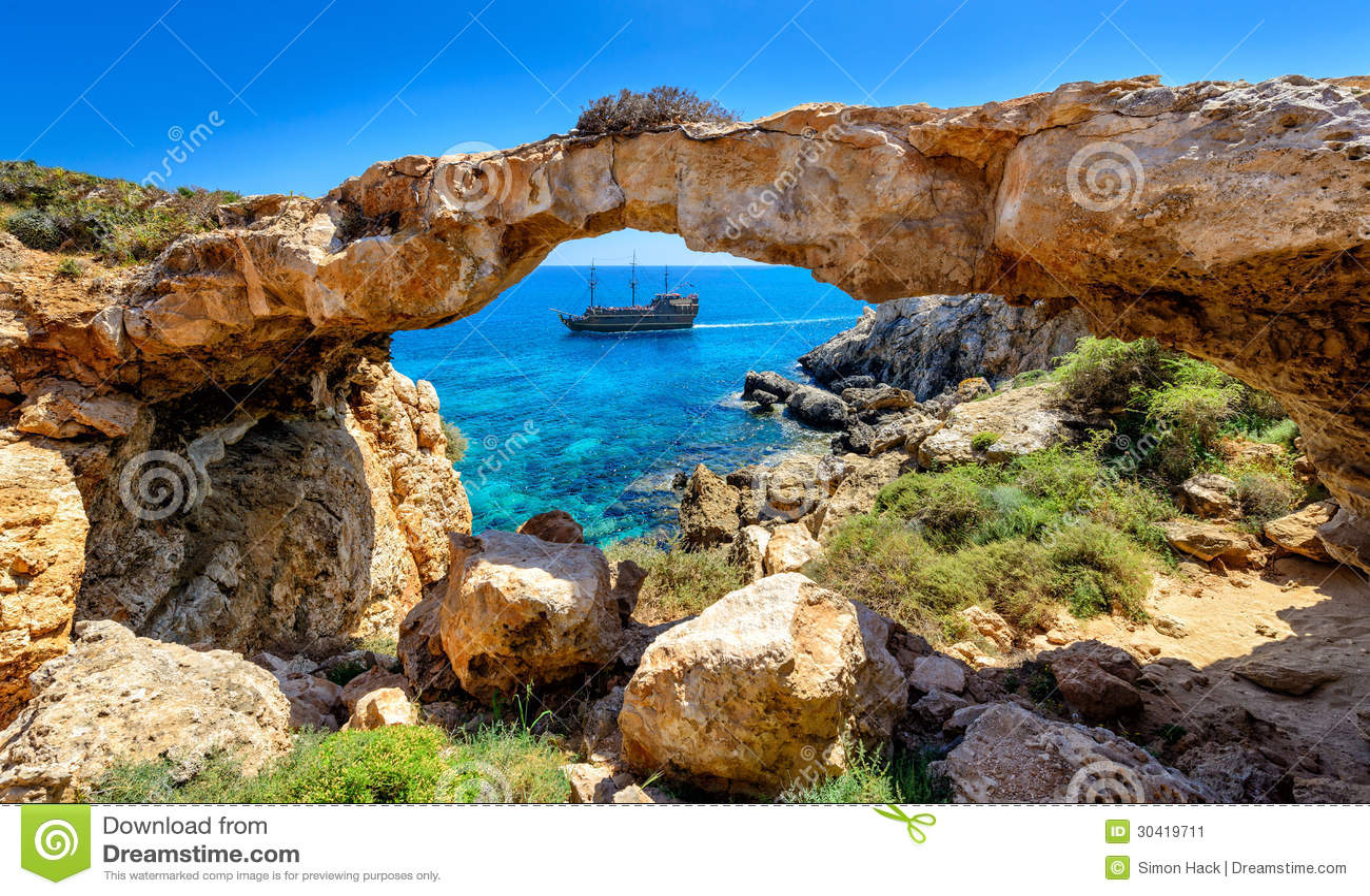 Pirate ship through rock arch,cyprus
