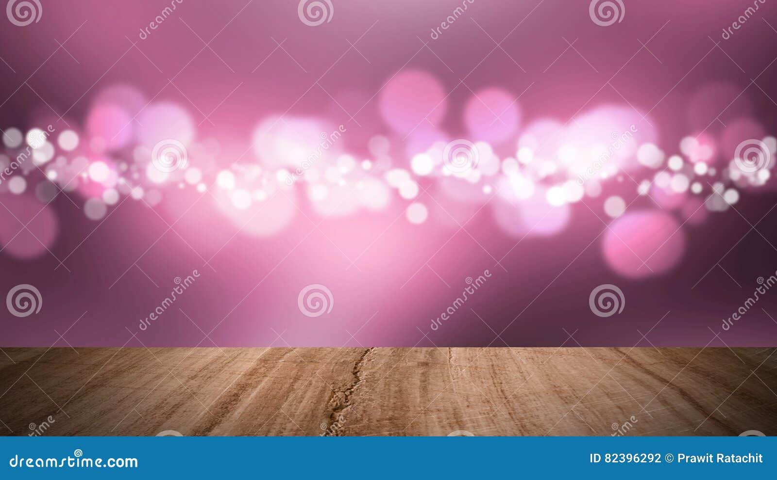 Piso de madera y fondo rosado del bokeh