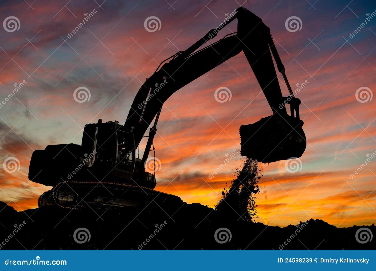 Pista-tipo excavador del cargador en el trabajo