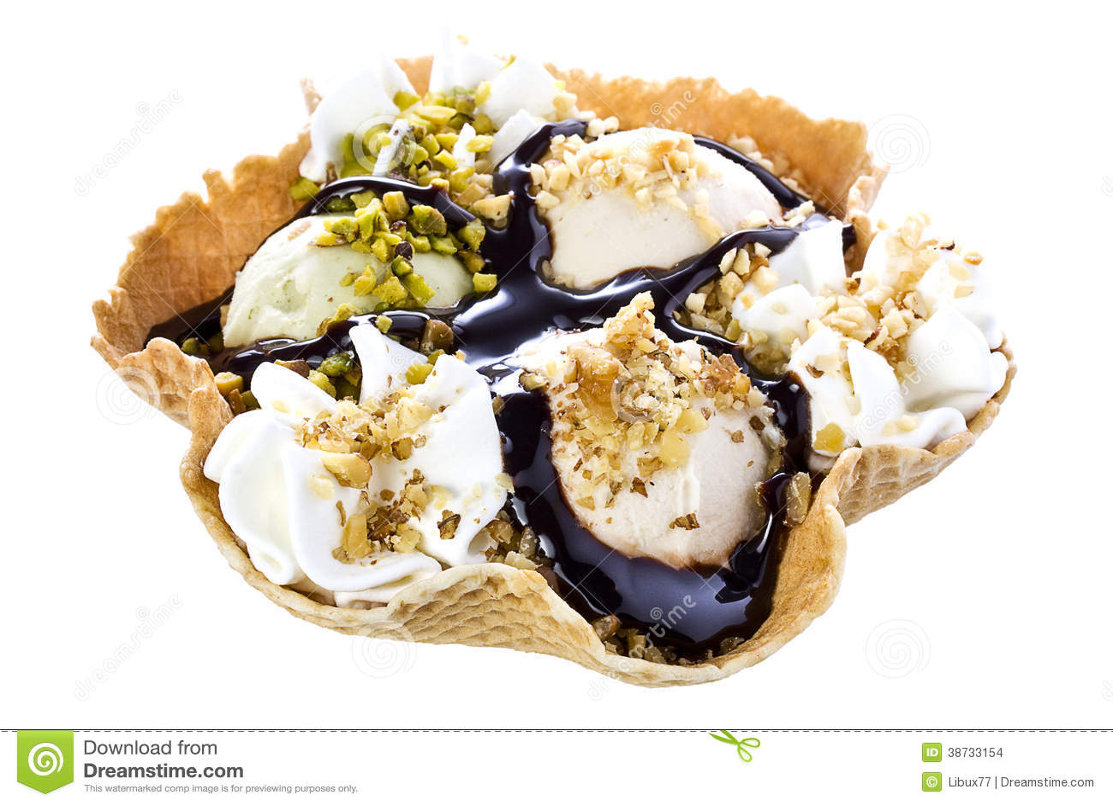 Waffle bowl filled with pistachio hazelnut walnut and chocolate syrup ...