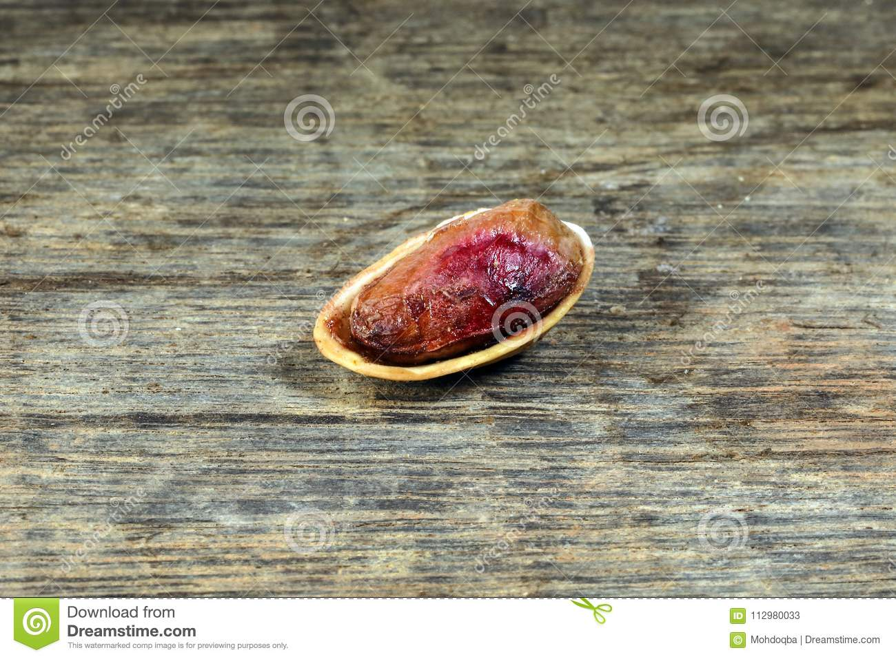 Pistachio nuts shell on rustic wood