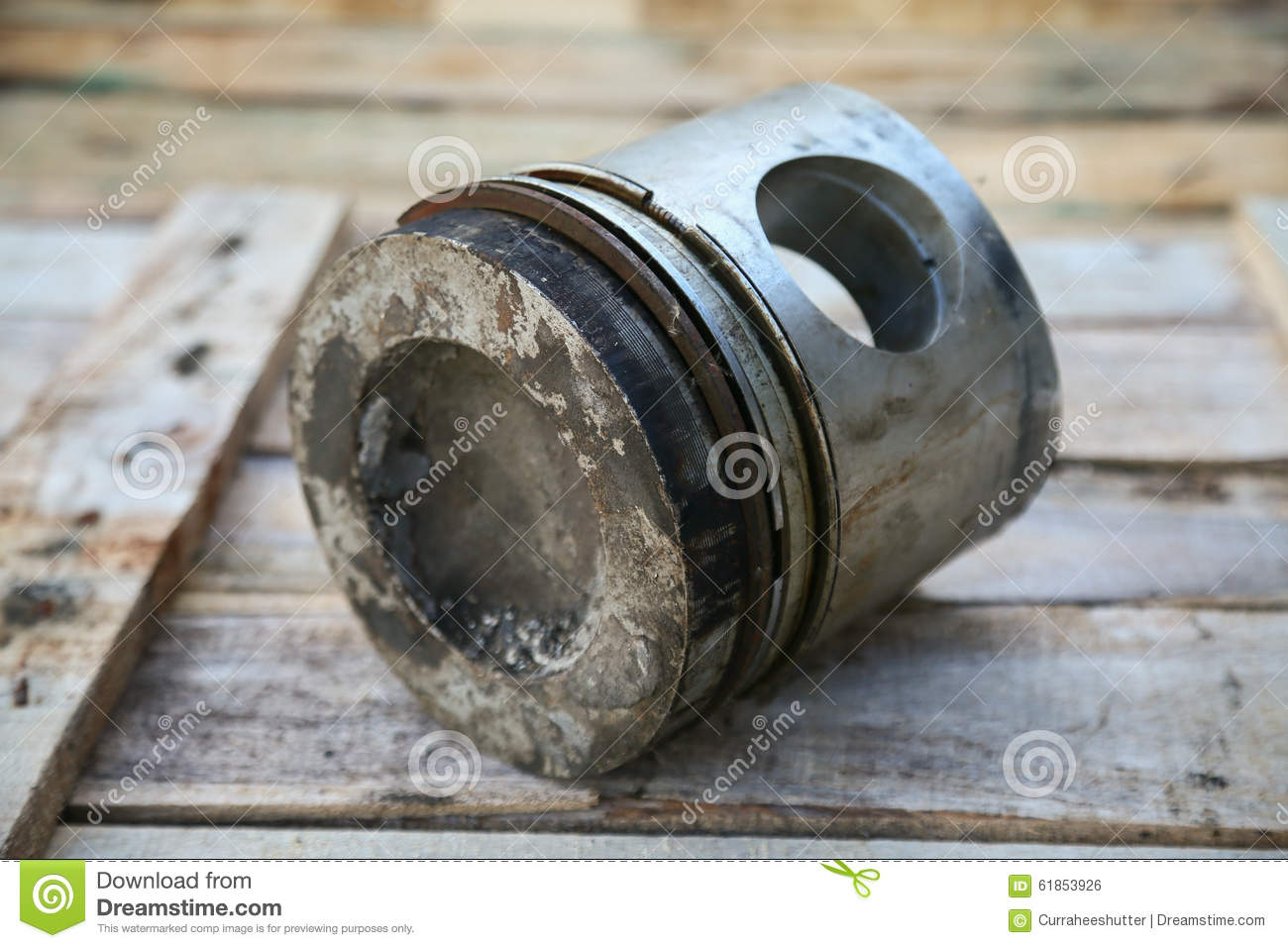 Locomotive Spare Parts : Piston of engine on wooden background auto parts industry