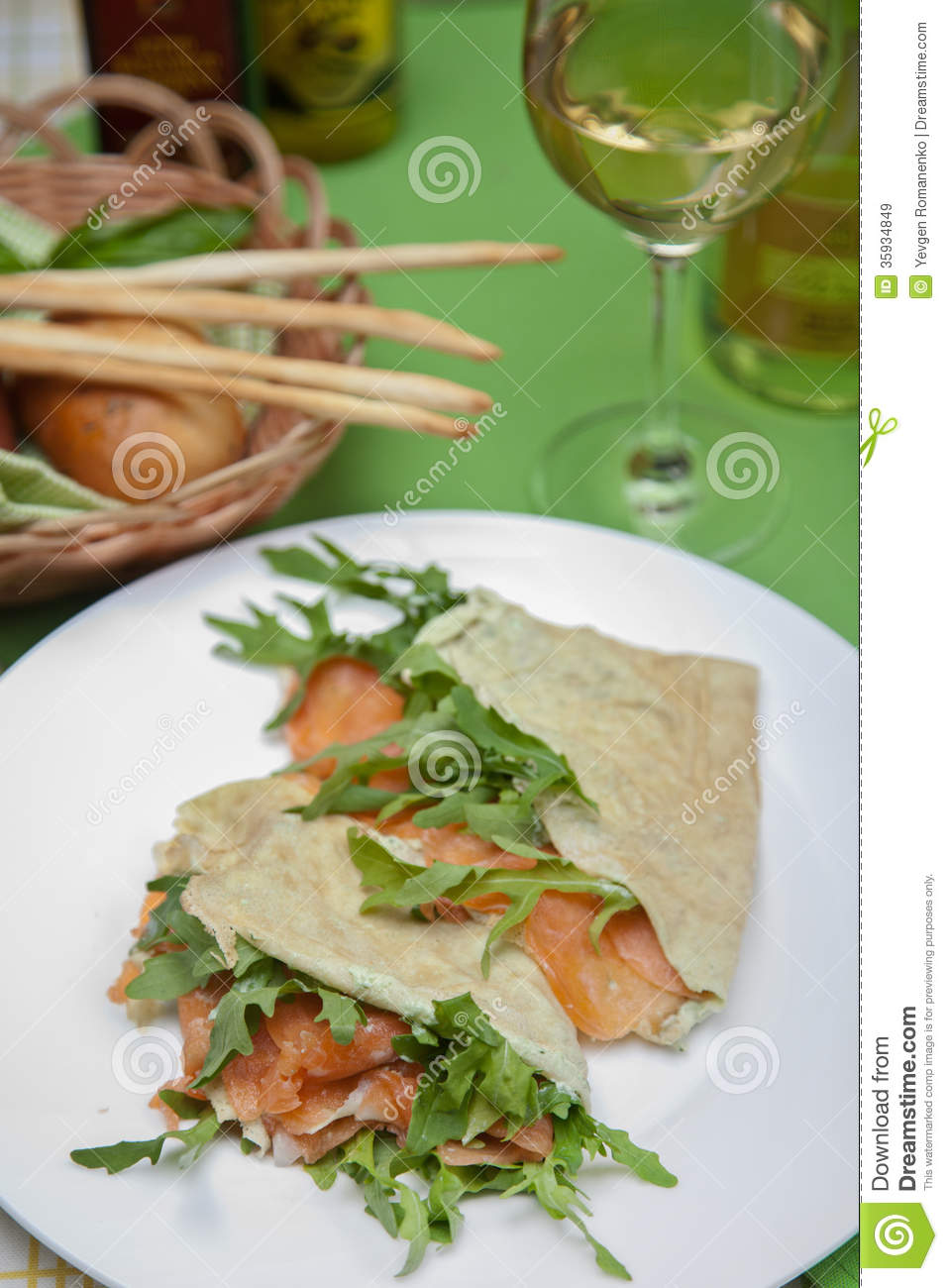 Pita bread with fish and arugula royalty free stock images for How to bread fish