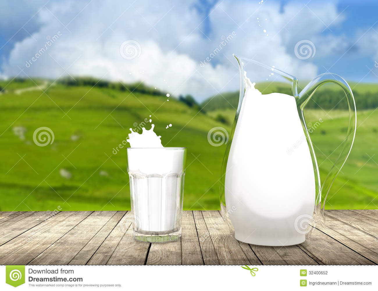 Pitcher And Glass Of Milk On Wooden Table Stock ...