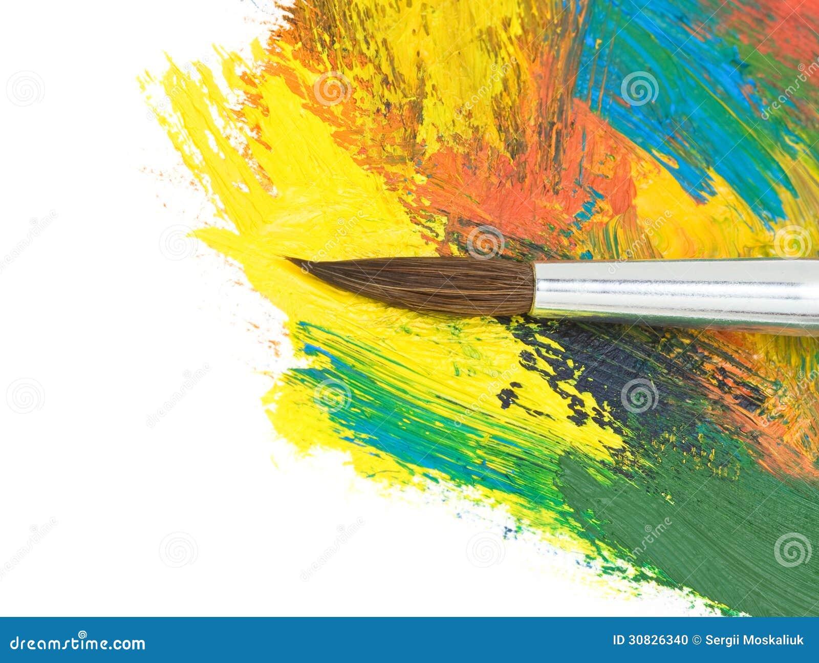 Pitture di colore e della spazzola su bianco