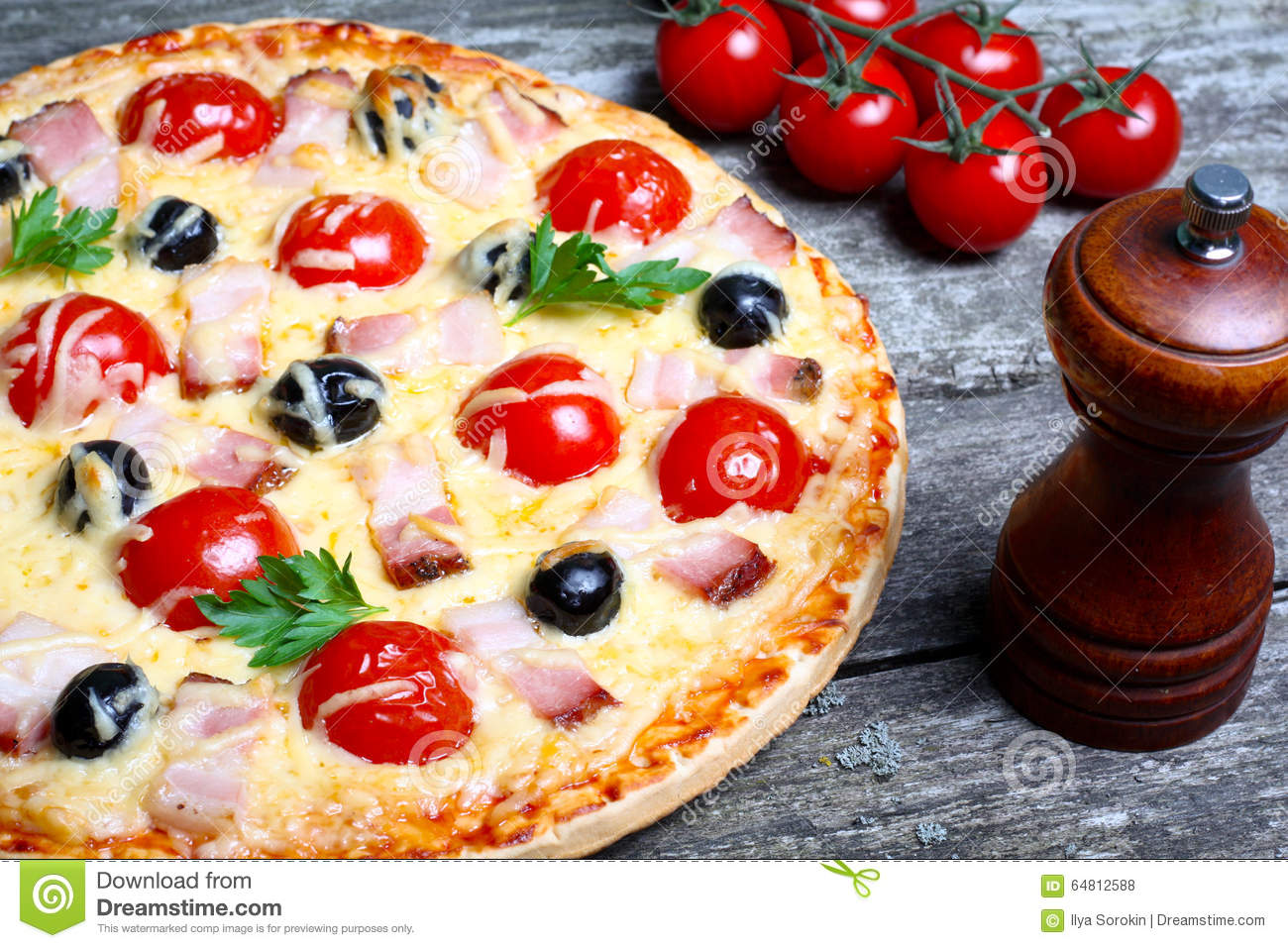 Pizza With Bacon, Olives And Tomato Stock Photo - Image: 64812588