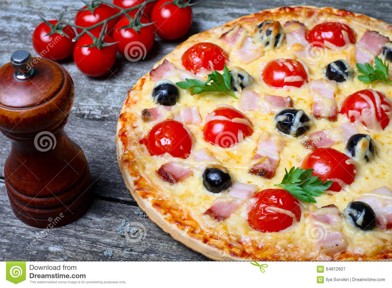 Pizza With Bacon, Olives And Tomato Stock Photo - Image: 64812607