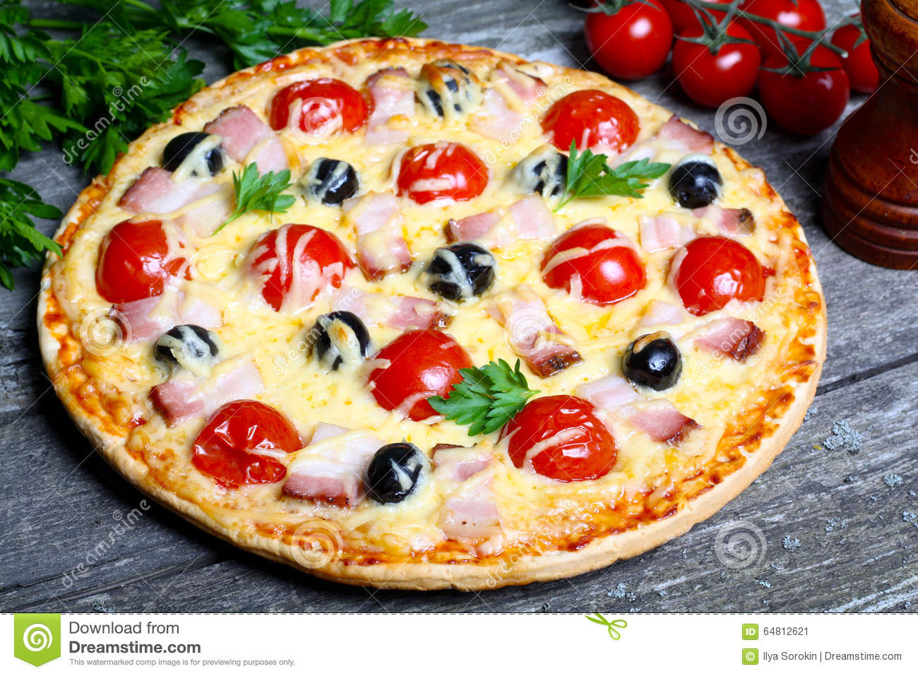 Pizza With Bacon, Olives And Tomato Stock Photo - Image: 64812621