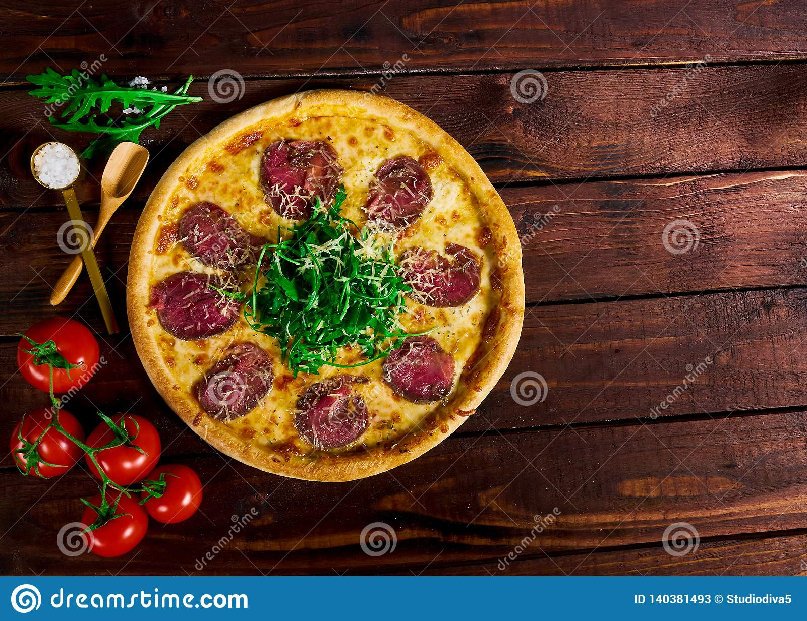 Pizza with beef on a wooden table. beautiful background
