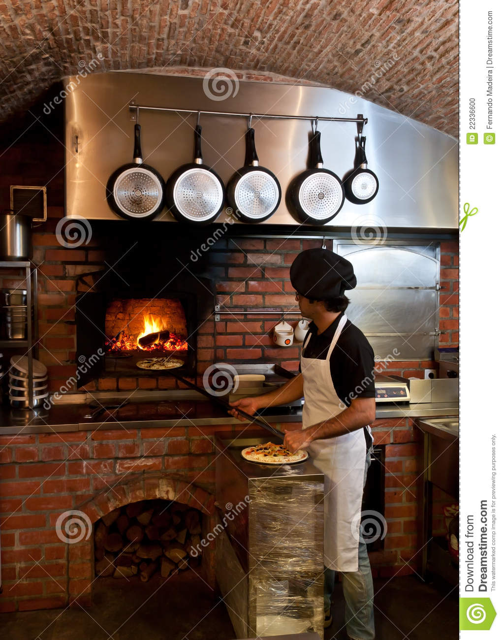 download pizza chef put the pizza inside the wood oven stock photo image of meal - Four A Pizza Interieur