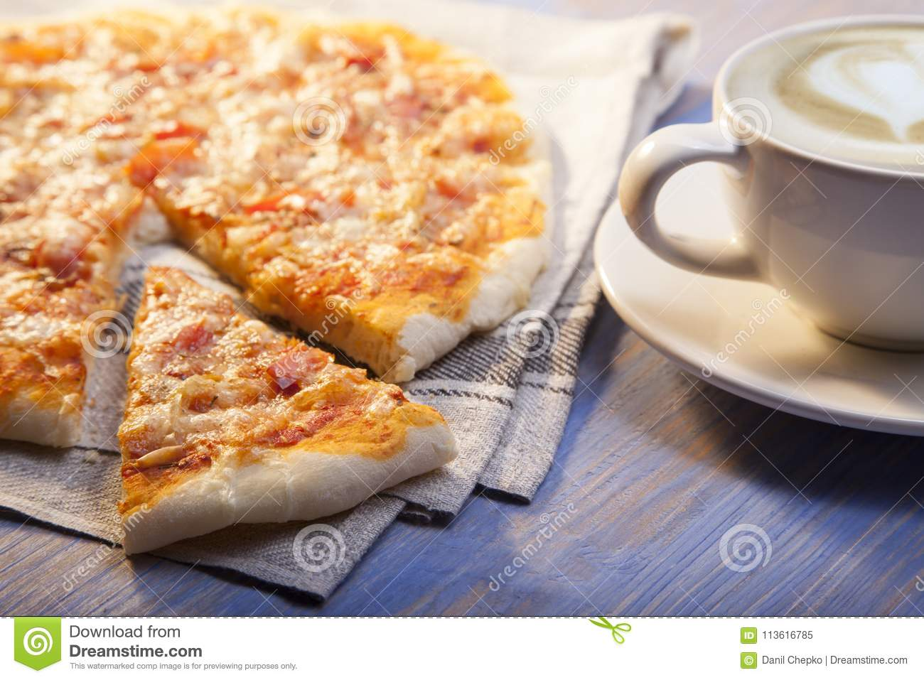 Pizza and Coffee on wooden table, cup of cappuccino.