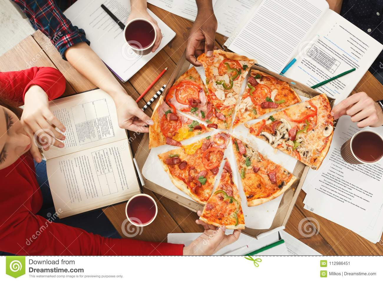 Students learning and eating pizza
