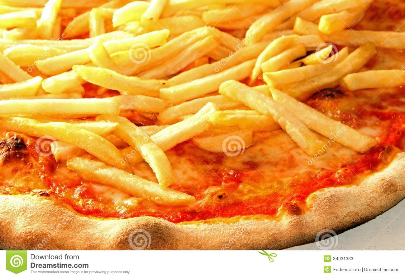 Pizza with French fries and mozzarella and tomato cooked on oven ...