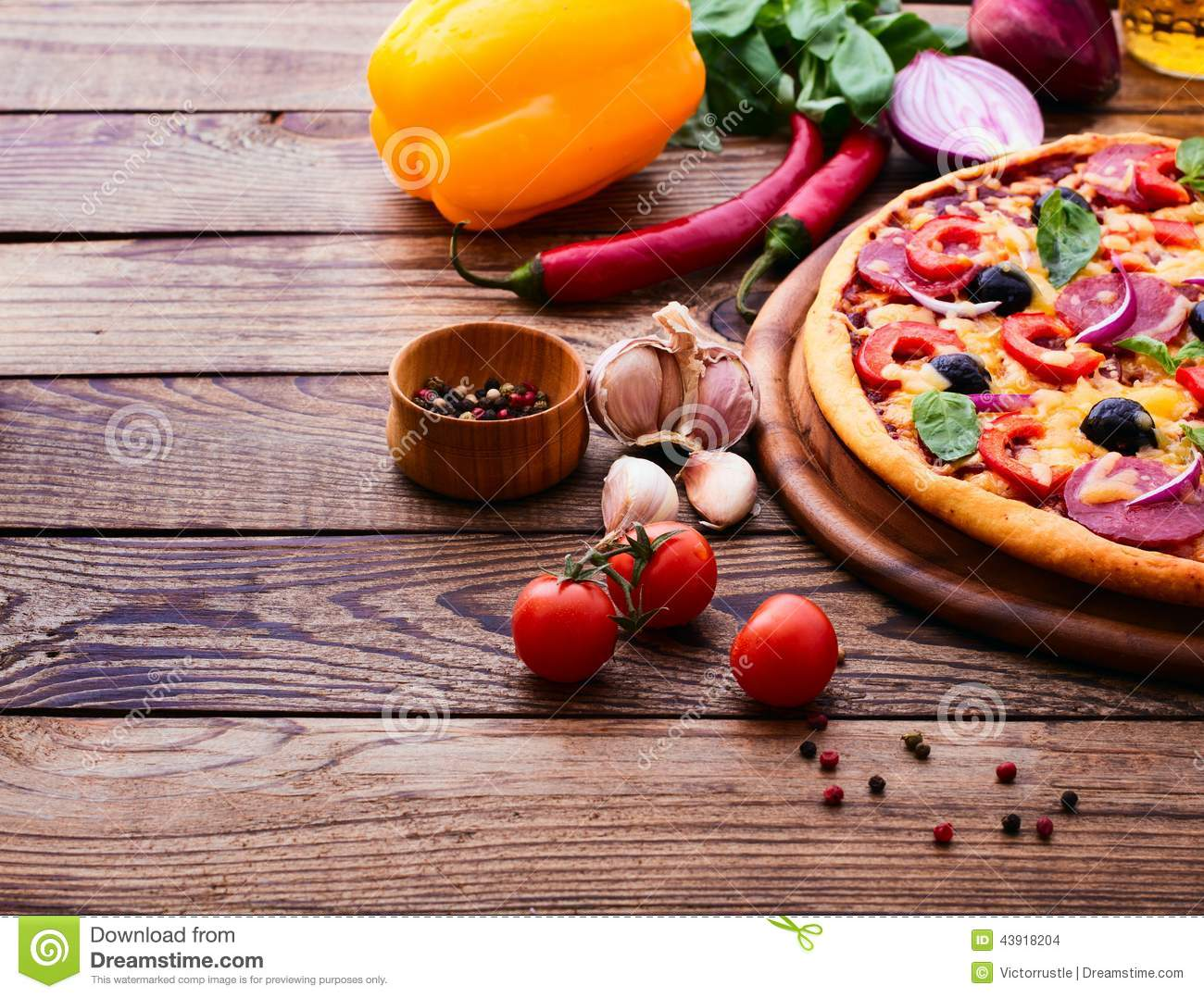 Wooden Food Table ~ Pizza with ham pepper and olives delicious fresh