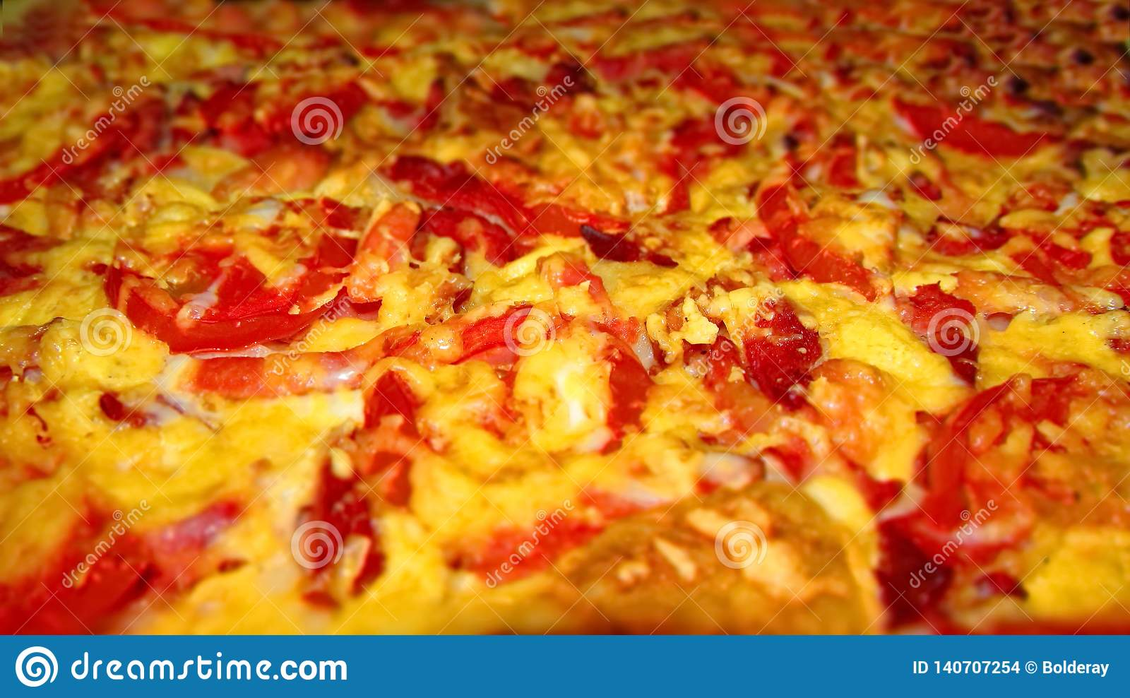 Pizza is an Italian national dish in the form of a round open cake, covered in a classic version with tomatoes and melted cheese.