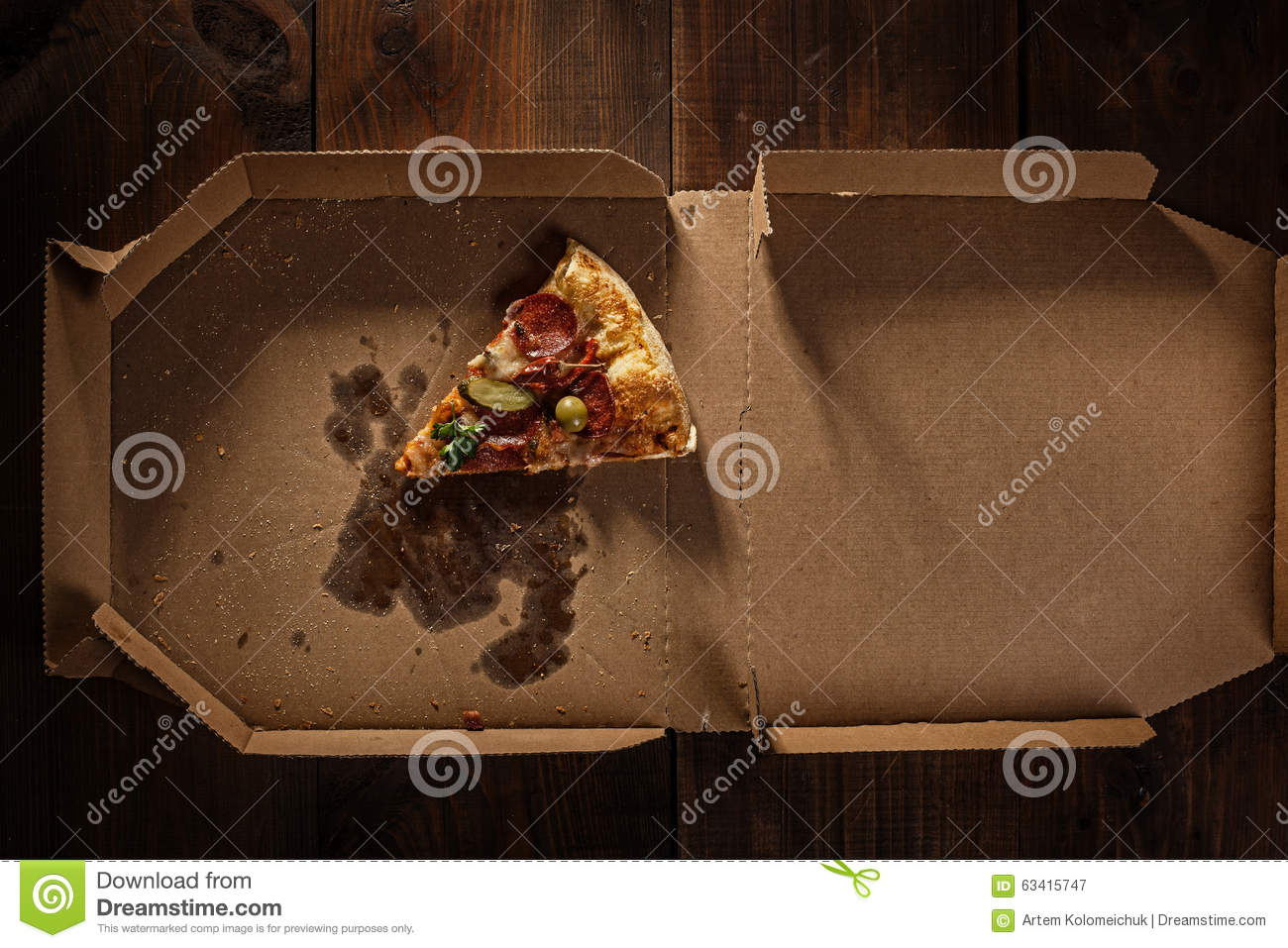 Pizza slice in the in delivery box on the wood