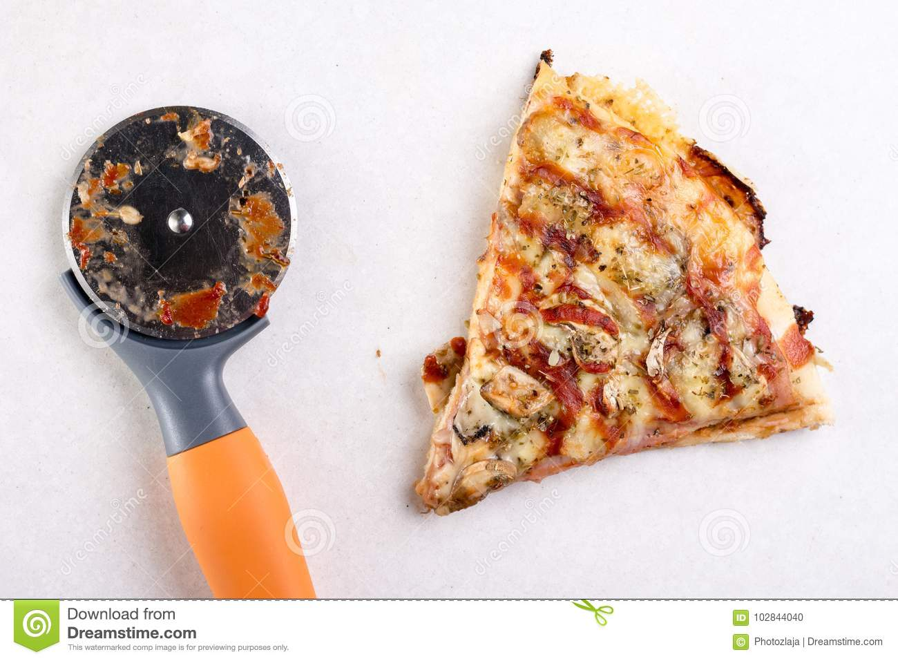 How Many Slices In Round Table Pizza.Pizza Slice With Round Pizza Knife On The White Marble Background