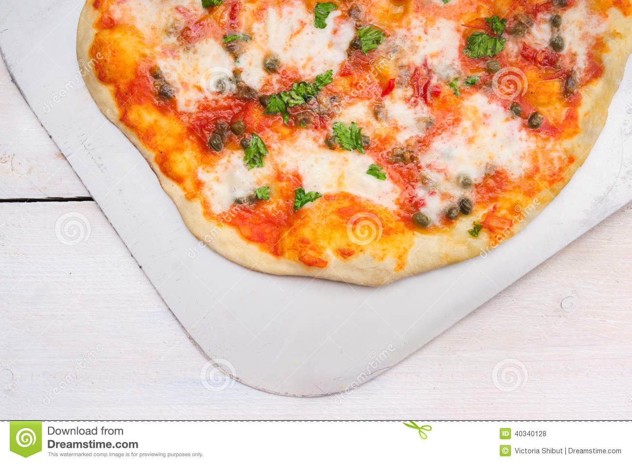 Pizza with tomatoes, basil,kapers and mozarela