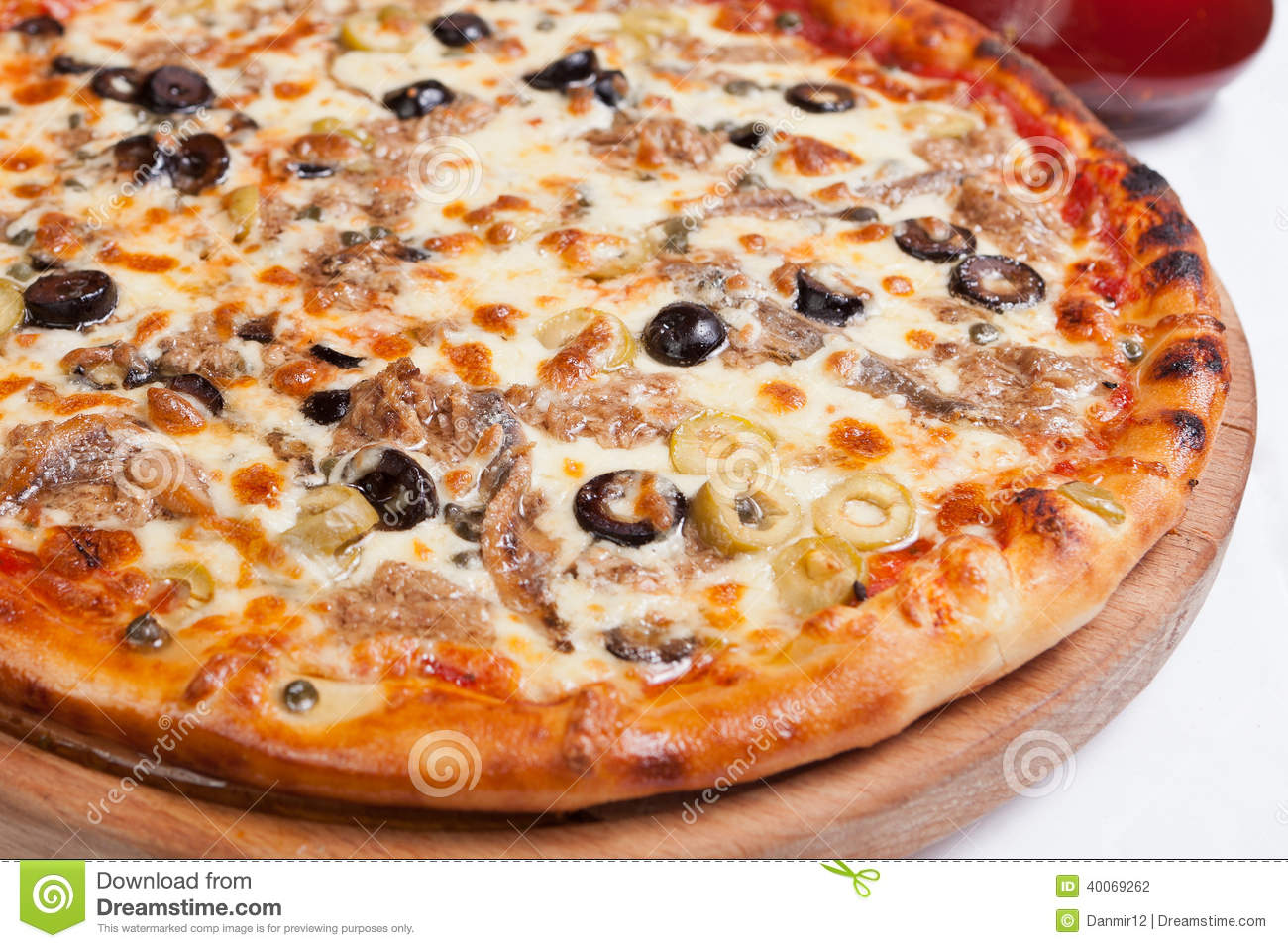 Pizza with ton fish on a wood plate stock photo image for Pizza and fish express