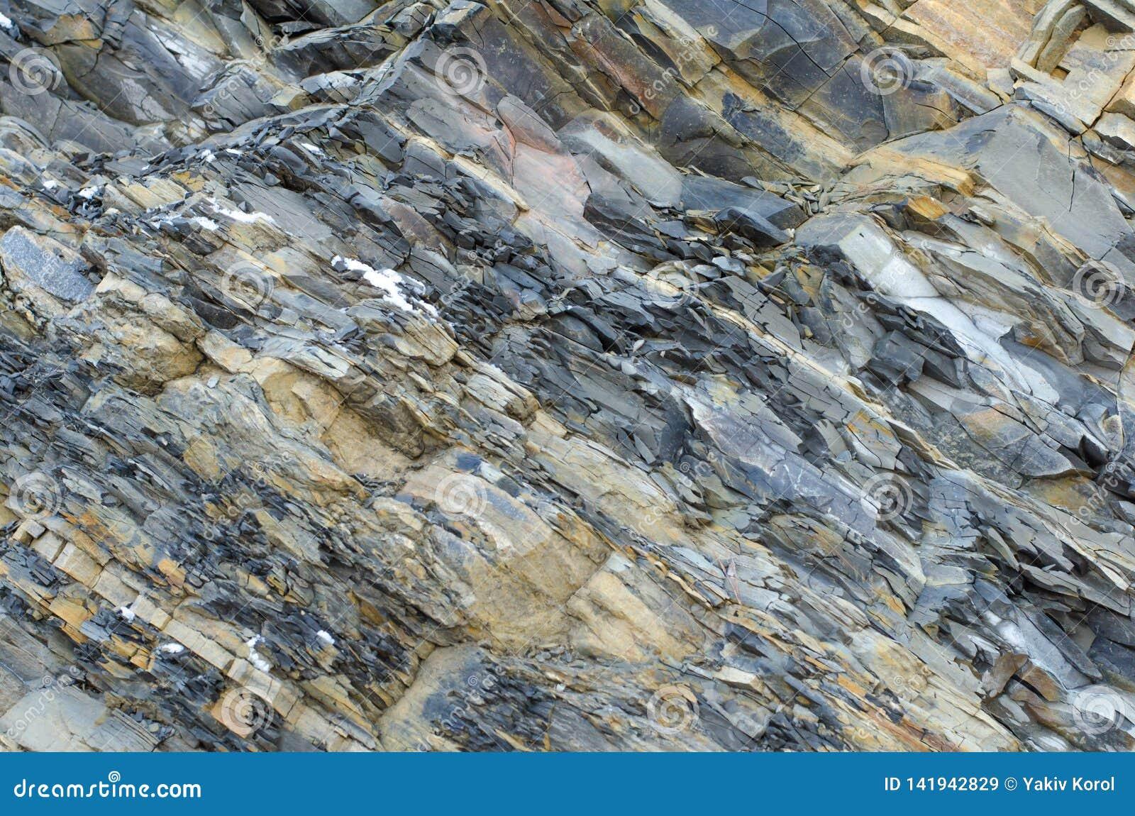 Pläterad sten Grå färg-guling kritiserar närbildbakgrund
