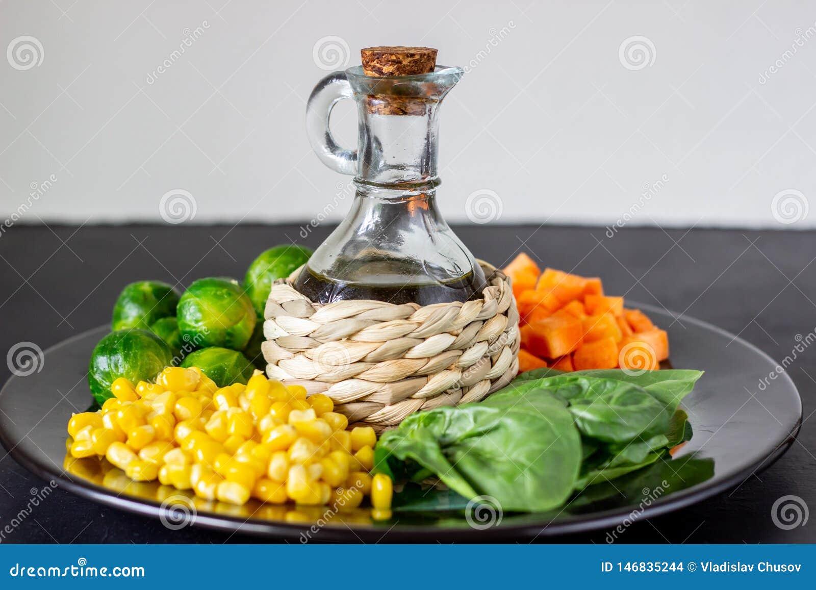 Plaat met kool, wortelen, graan en spinazie Het gezonde Eten