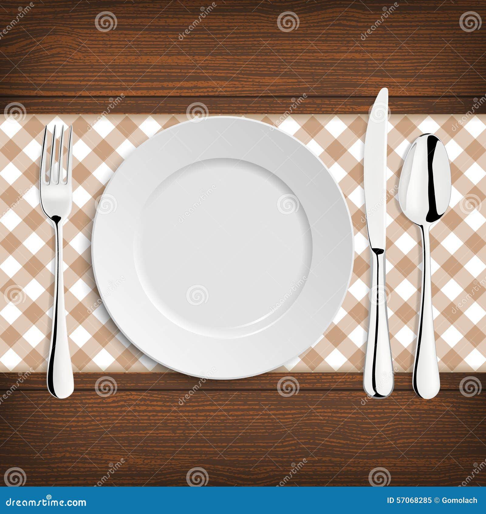 Plaat met lepel, khife en vork op een houten lijst