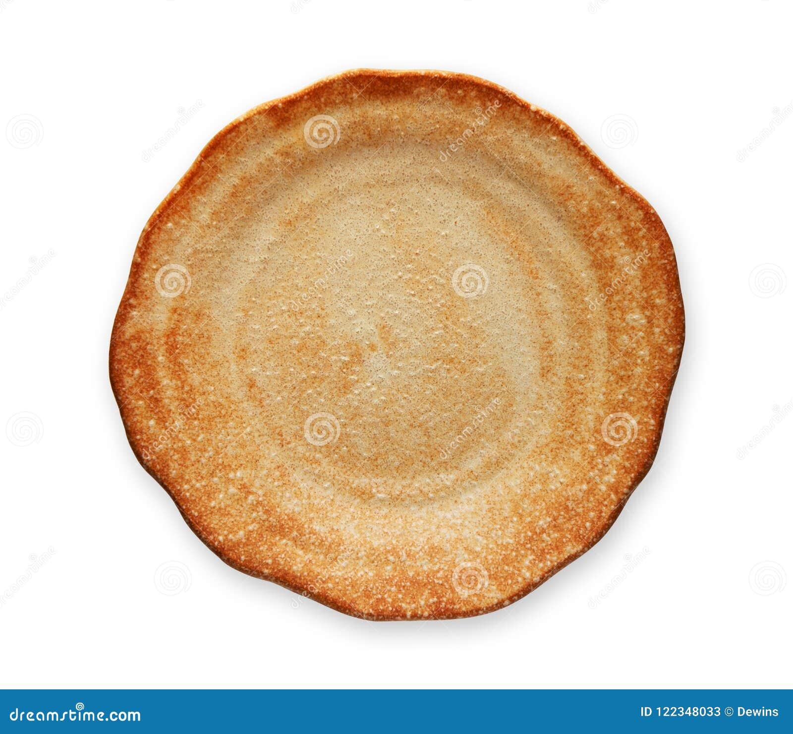 Placa blanca vacía con el borde ondulado, placa de la panadería, visión desde arriba aislada en el fondo blanco con la trayectori