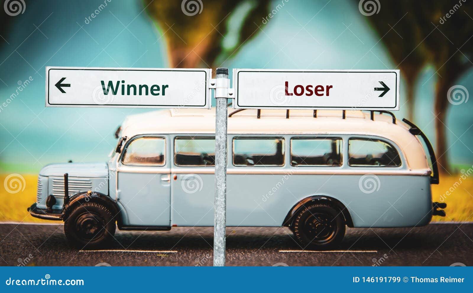 Placa de calle al ganador contra perdedor