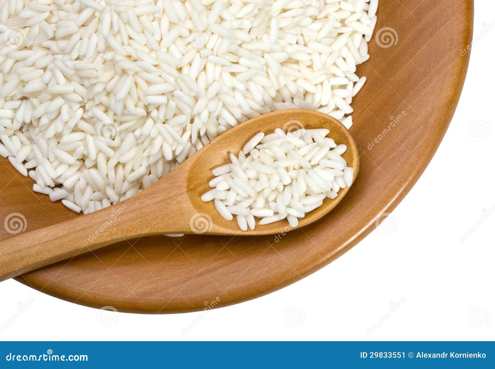 Placa de madeira com grões do arroz