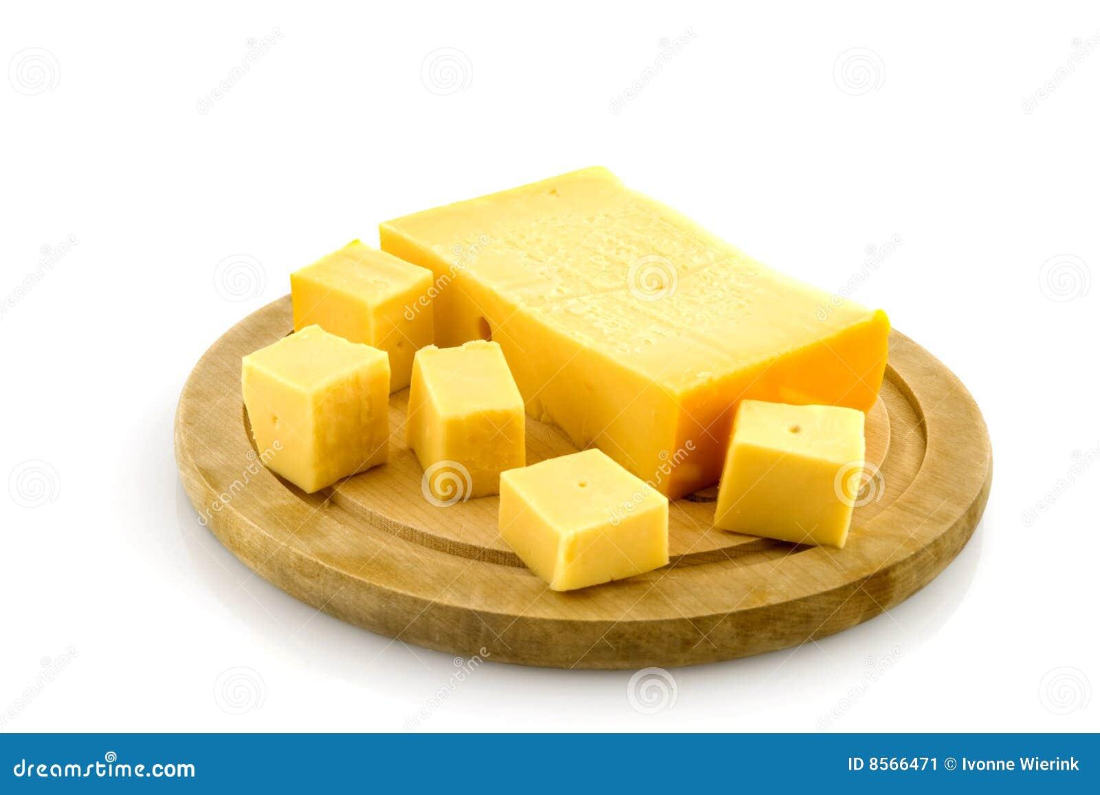 Placa de madera con queso