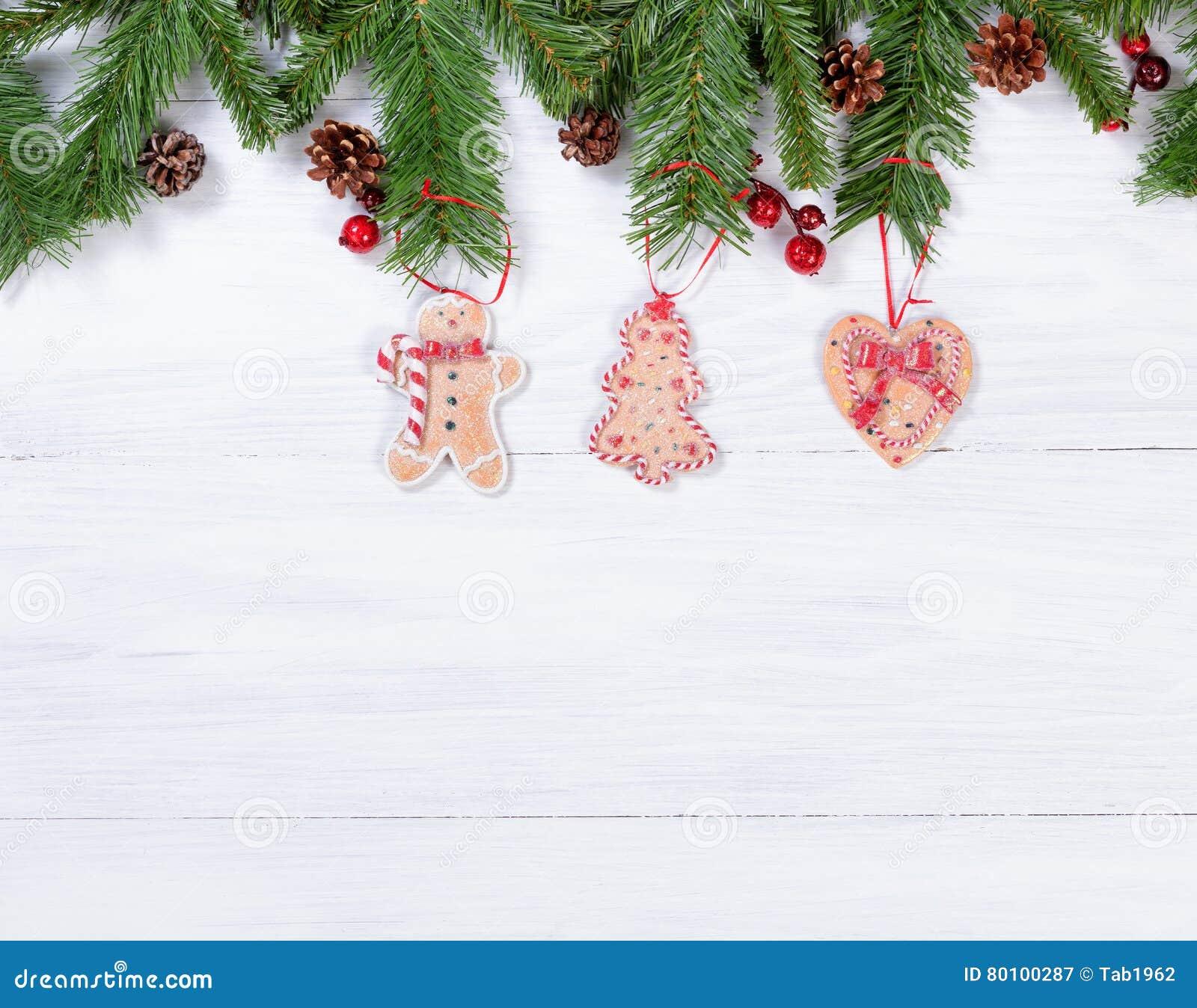 Placas de madeira brancas rústicas com as decorações han da cookie do Natal