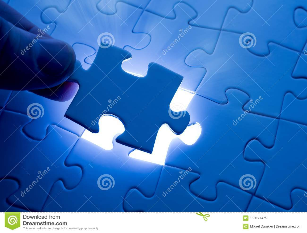 Placing last piece of jigsaw puzzle