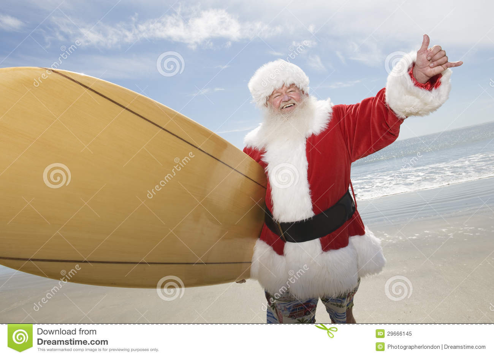 Plage de Santa Claus With Surf Board On