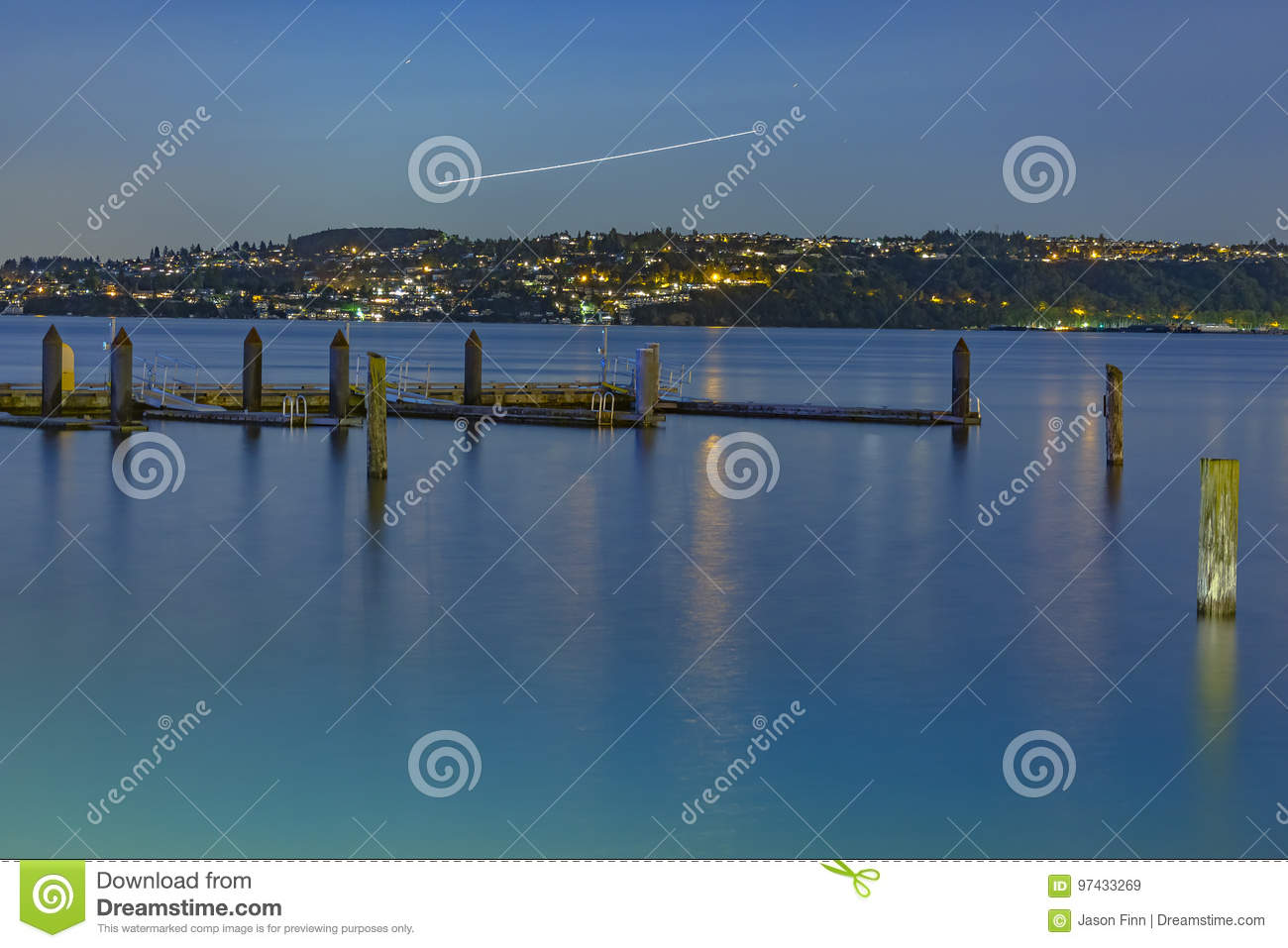 Plain Trails At Night With The Dock And Old Wooden Pillars