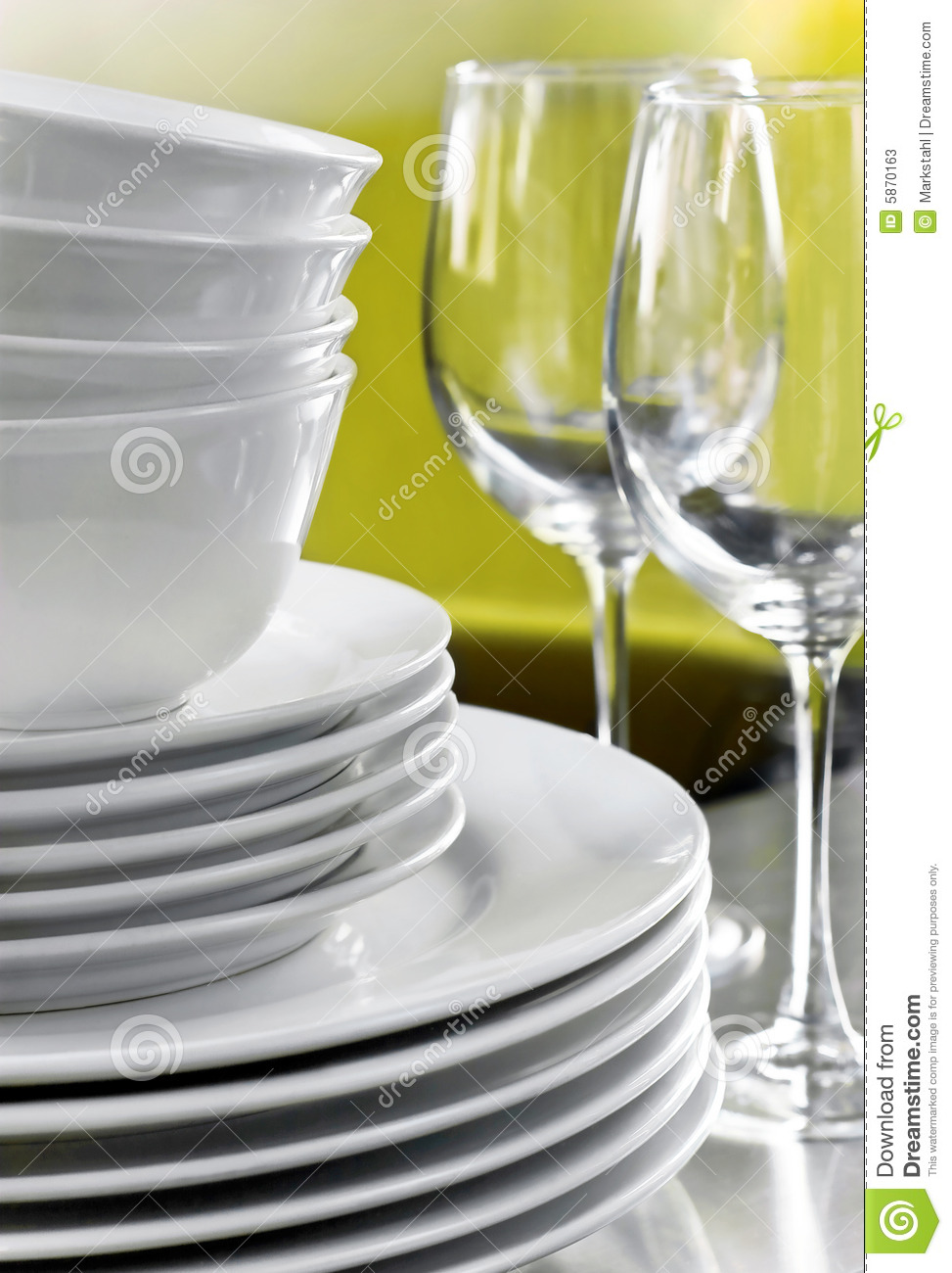 Plain White Plates Bowls and Crystal Wine Glasses