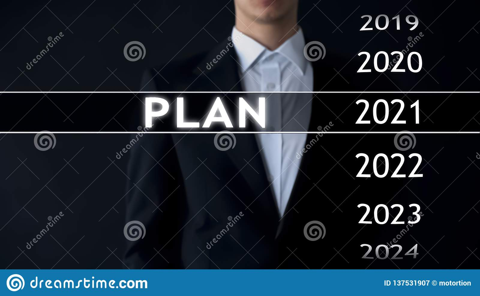 Plan for 2021, businessman chooses file on virtual screen, startup strategy
