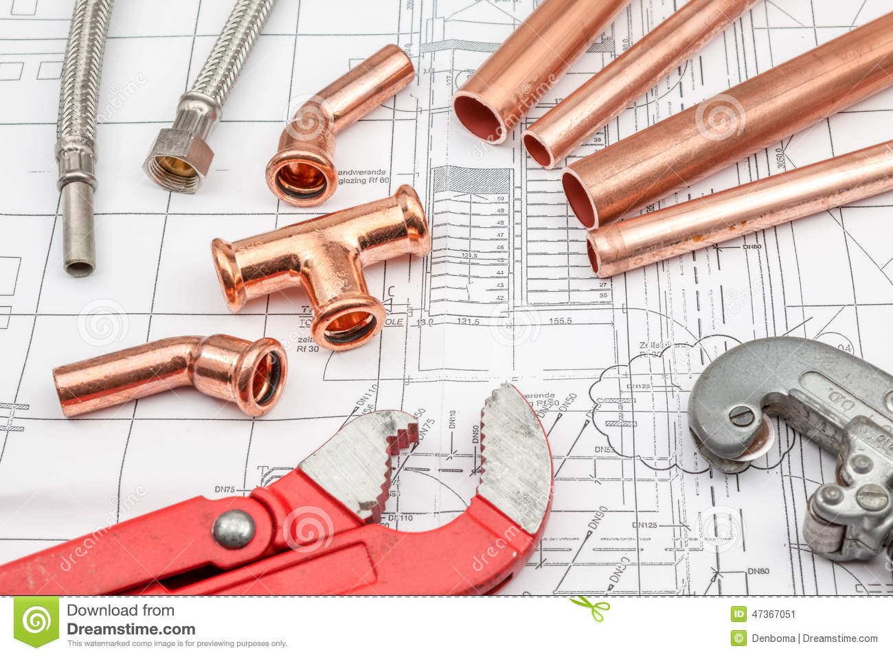 Plumbing tools arranged on house plans royalty free stock for Plumbing a new house