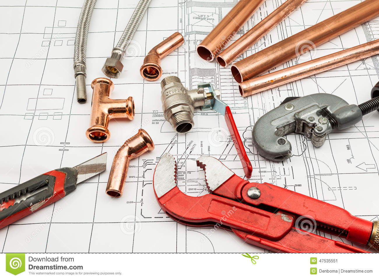 Plumbing tools arranged on house plans royalty free stock for Building design tool online