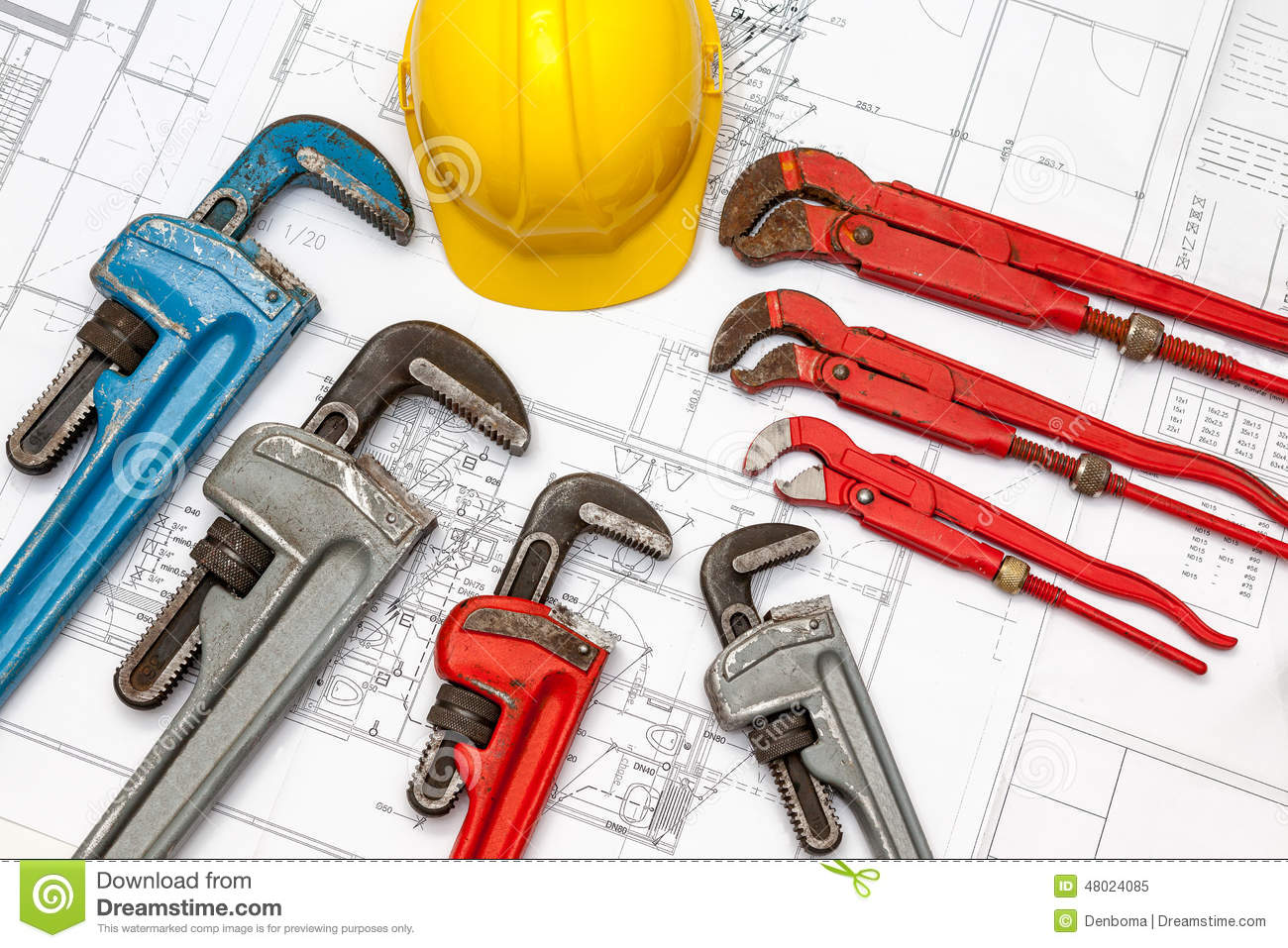 Plumbing tools arranged on house plans royalty free stock for Building design tool