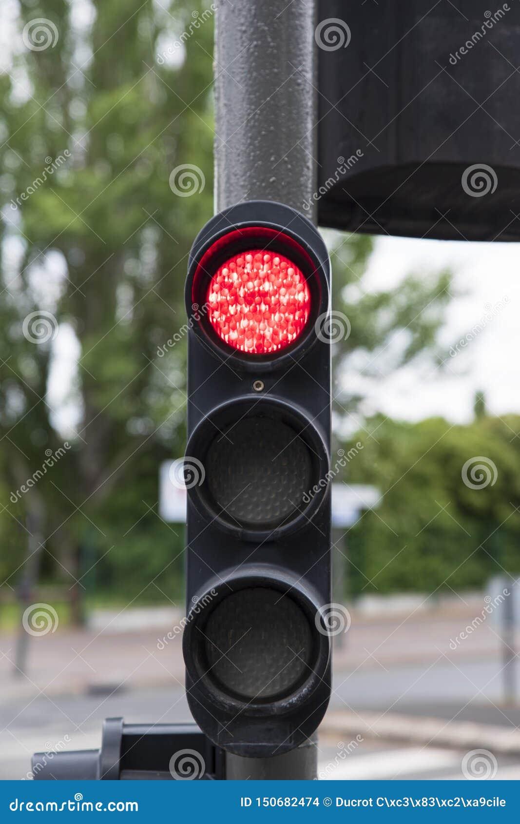 Plan rapproché d un feu de signalisation rouge