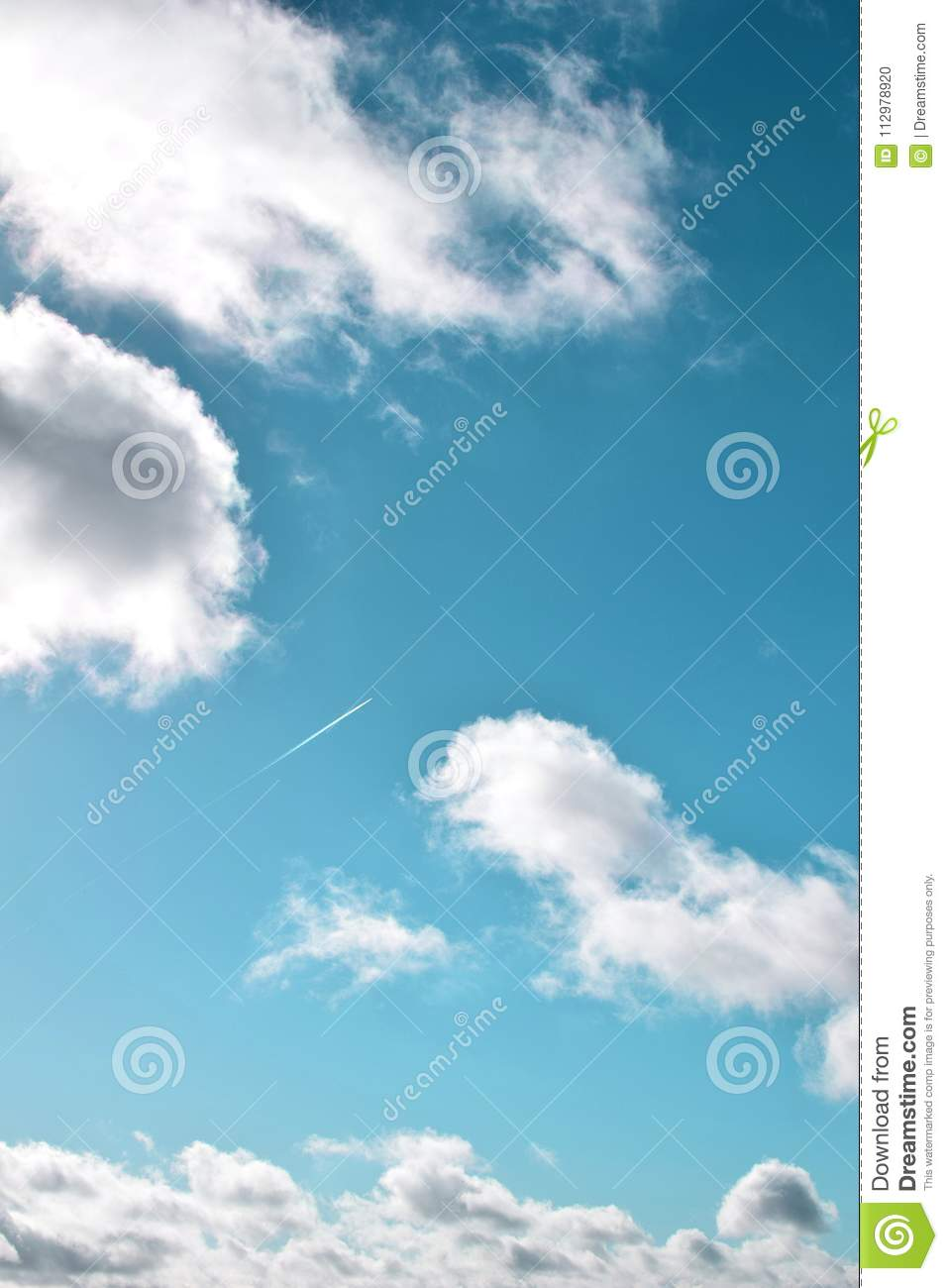 A plane in a cloudy and turquoise sky