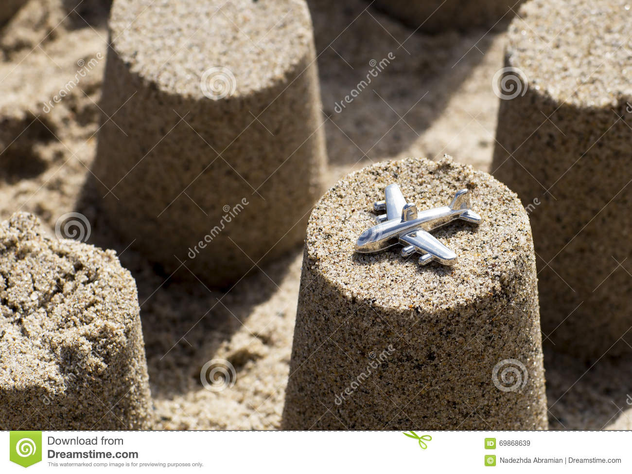 eehnie+russian AC vs all others Plane-cone-figure-made-beach-sand-figures-light-shadow-69868639
