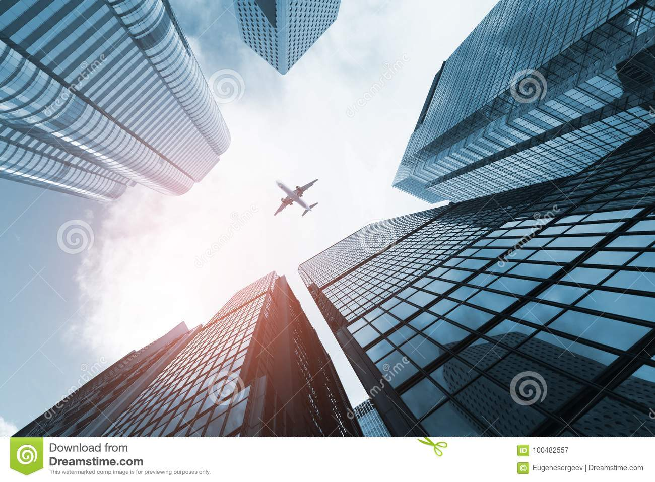 Plane flying over business skyscrapers